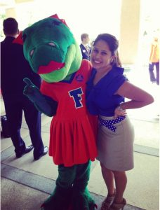 Image of Loren Parra with Alberta, UF's female alligator mascot